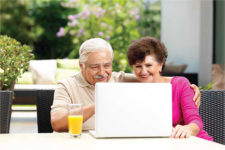 Couple on laptop to shop for medicare plan and enroll in medicare.
