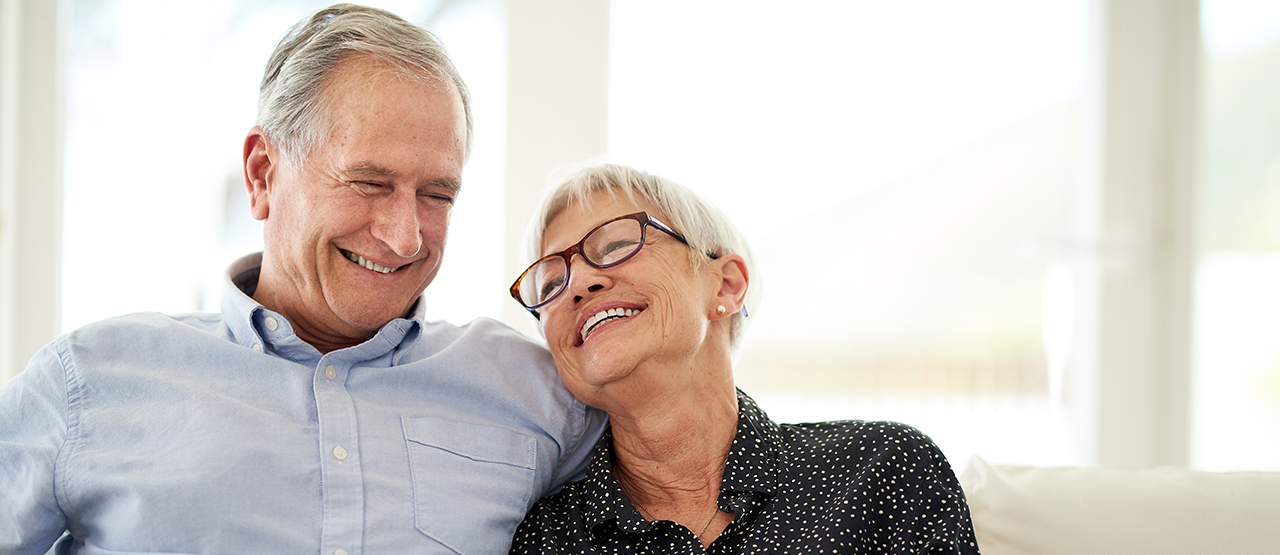 Senior couple talking about how fun it is to shop for Medicare