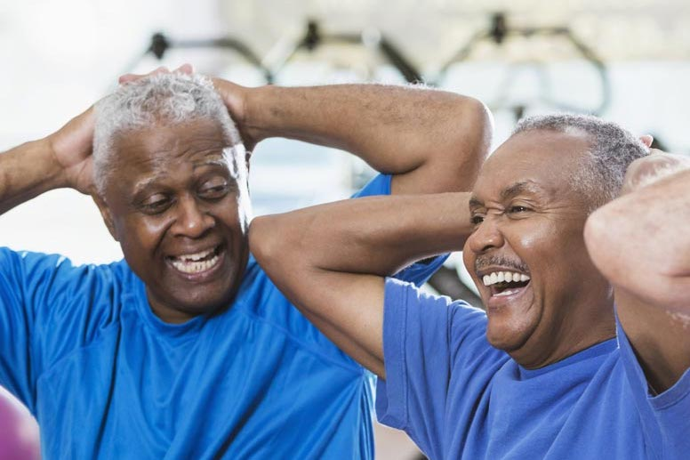 a caregiver and senior man working out together