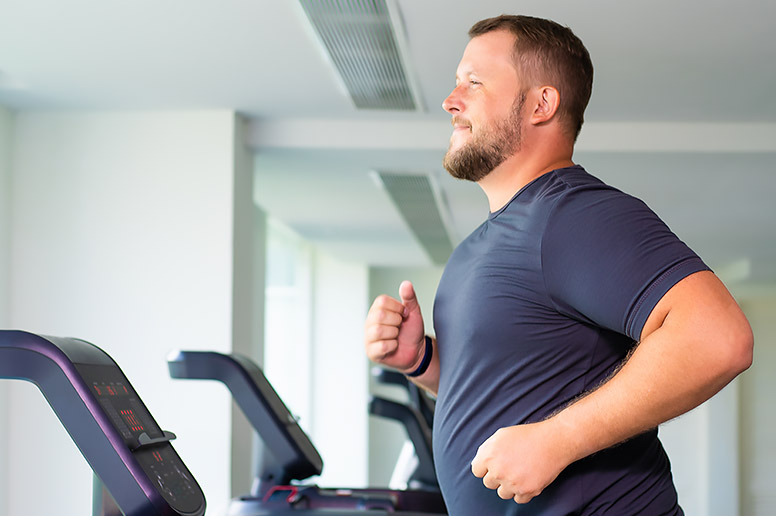 man exercising on treadmill to lower diabetes risk