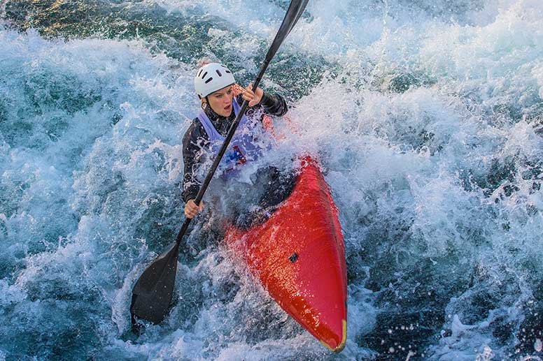 Woman white water rafting