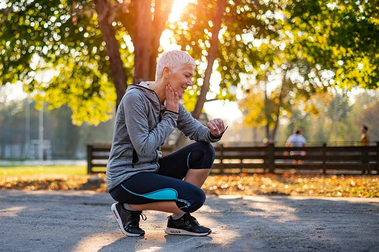 Senior Athletic Woman Checking Heart Rate After Running in the Park