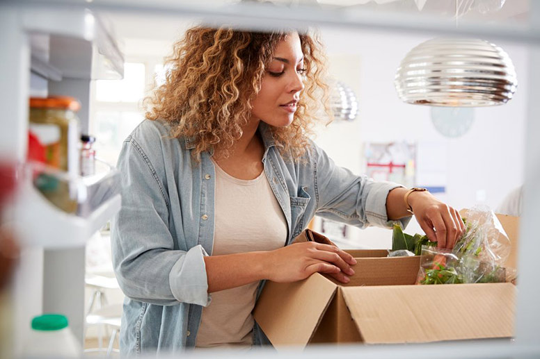 Woman unpacking food