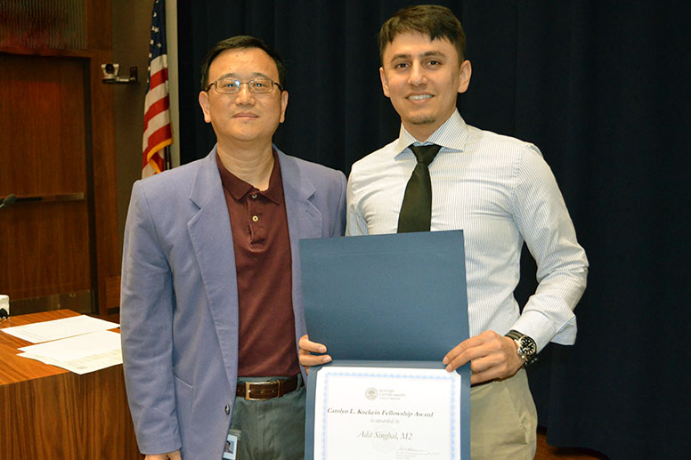 Adit Singhal (right), MD Class of 2020, with his mentor Jun Ling, PhD (left), associate professor of molecular biology.