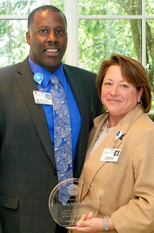 Arthur Breese presents Amy Brayford with the inaugural Abigail Geisinger Diversity Champion Leadership Award