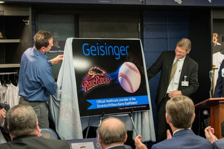 Former Yankee Andy Ashby and Dr. Anthony Aquilina unveil the Geisinger RailRiders partnership