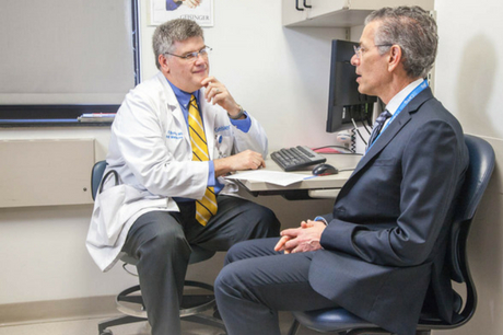 Dr. Gregory Burke discusses medical care with Dr. David Feinberg.