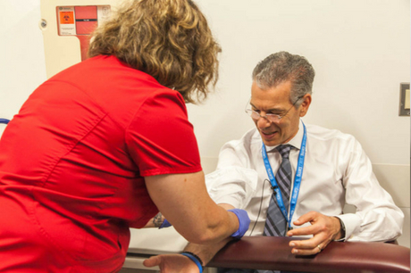 Dr. David Feinberg gets his blood drawn.