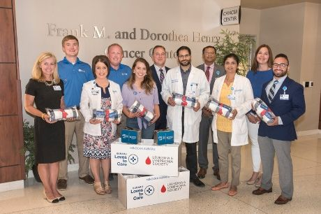 Members of Geisinger Community Medical Center prepare to deliver blankets from Subaru and the Leukemia and Lymphoma Society