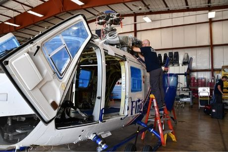 Life Flight maintenance team member working on a helicopter.