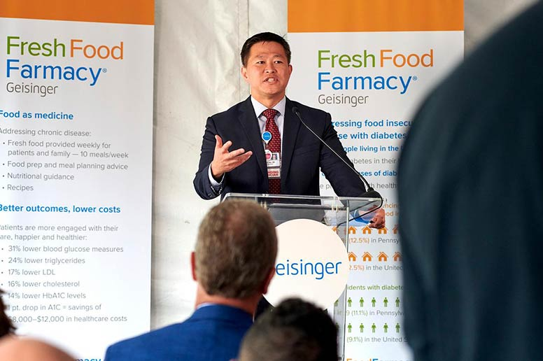 Dr. Jaewon Ryu addresses the crowd at the Scranton Fresh Food Farmacy opening.