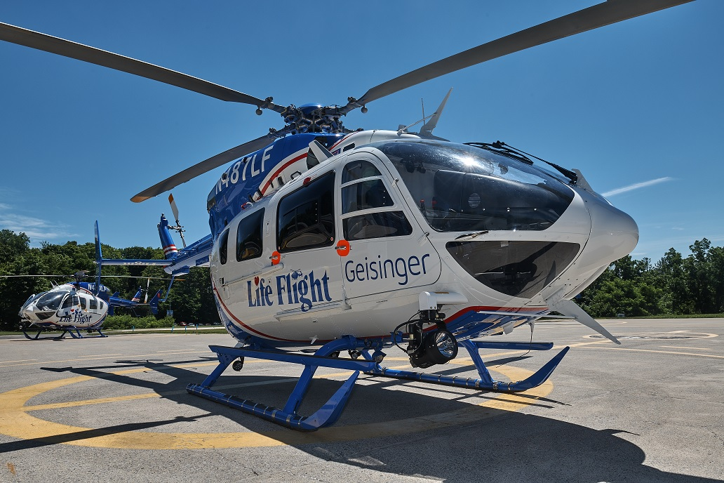 A Geisinger Life Flight helicopter sits on the helipad.