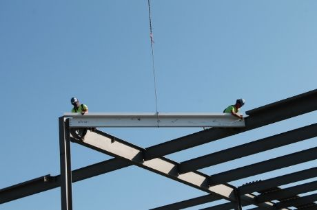 Construction workers set the final steel beam into place at Geisinger Medical Clinic Lock Haven.