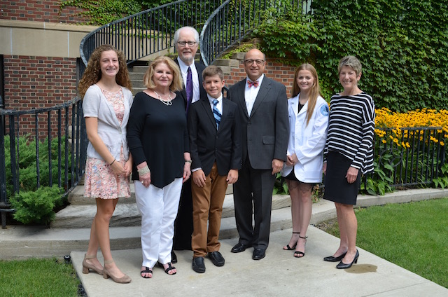 Seen from left are members of the Poorman family — Kathleen Simander, Pamela Fisher-Poorman, Stephen Poorman and Colin Simander – meeting with Steven J. Scheinman, M.D., president and dean of Geisinger Commonwealth School of Medicine; Poorman scholarship recipient, Alexa Mills of Renovo; and Susan Mathias, senior regional director of advancement, central-west, Geisinger Health Foundation.