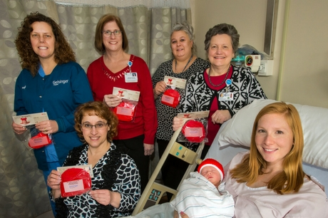 Geisinger Holy Spirit staffers show off their work with the Little Hats, Big Hearts campaign
