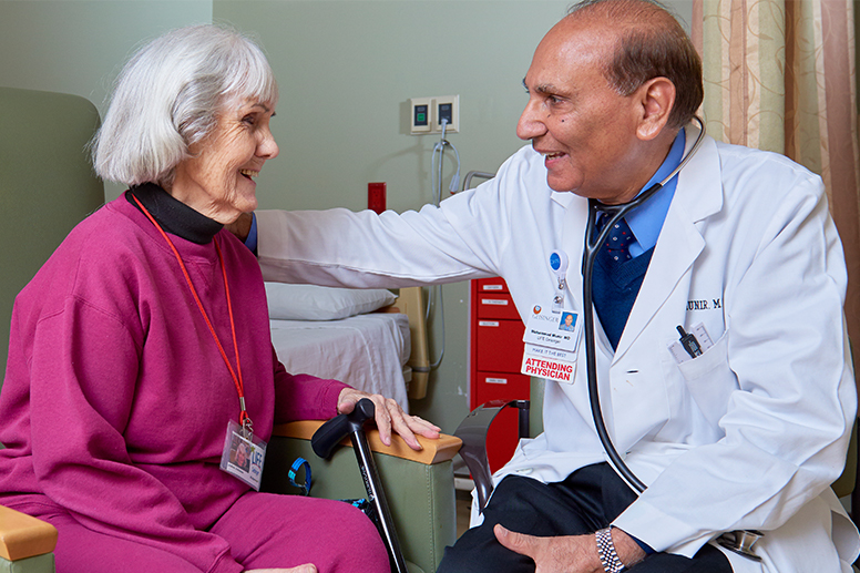 In the service of caring - A woman talking to her doctor
