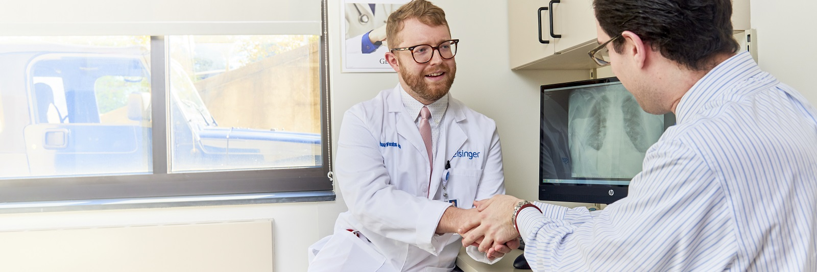 Doctor shaking patient hands