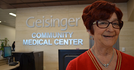 Woman in red smiling - Geisinger Community Medical Center