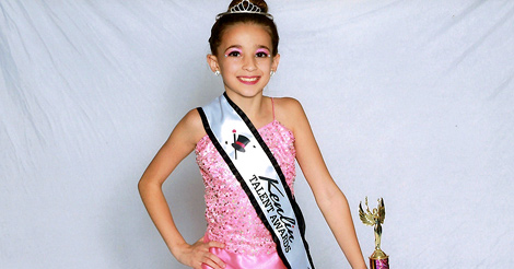 8-year-old dancer and gymnast is back on the stage after a major arm surgery