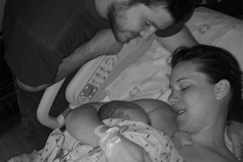 Tiffany and Alex Boozel with their newborn son, Konner.