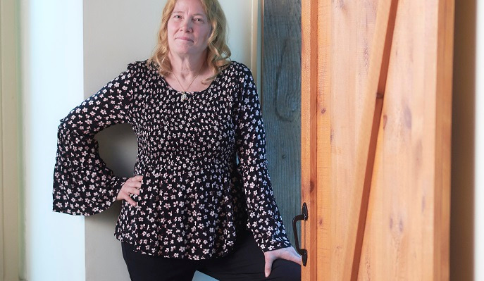 Cynthia Wysocki stands in the doorway of her Danville home, after adopting a healthy lifestyle with the help of Geisinger's Preventing Diabetes program.