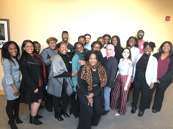 Vicki T. Sapp, PhD, director of student engagement, diversity and inclusion at Geisinger Commonwealth School of Medicine and a large group of medical students who attended a Racism in Medicine conference at Drexel University's College of Medicine.