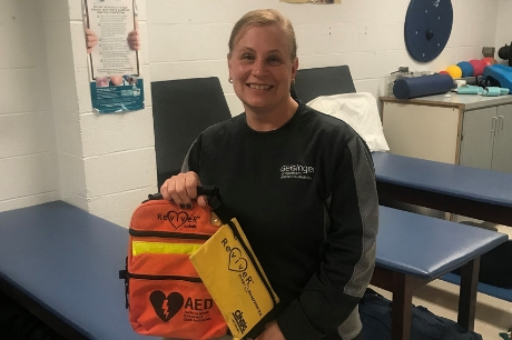 Geisinger certified athletic trainer Robin Jackson with his automated external defibrillator (AED).