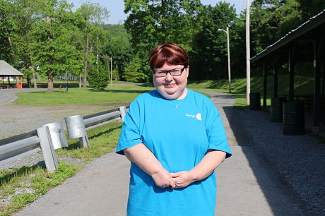 Jenn Kauffman, standing and smiling, during the 13th annual Walk in the Park for Arthritis.