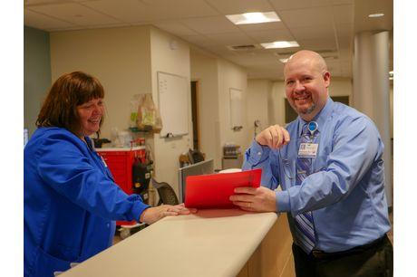 Nurse Dawn Erfman and chief advanced practitioner Bret Stemrich review a file in the Geisinger Kingston Clinic.