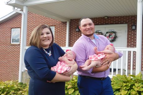 Garrett and Maddie Armstrong with their twin baby girls.