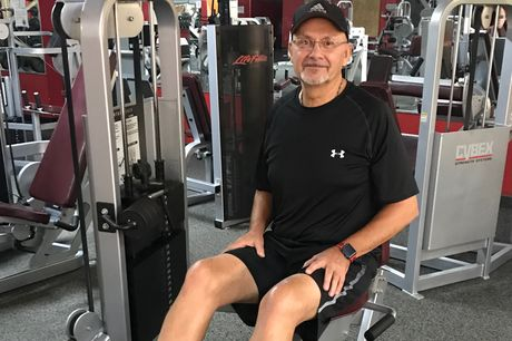 Bob Romanaskas demonstrates the sturdiness of his two new knees on some gym equipment.