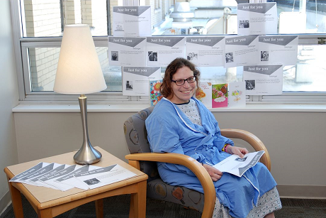 Katie Cowfer, a patient at Geisinger Medical Center, is surrounded by postcard notes from friends and family.