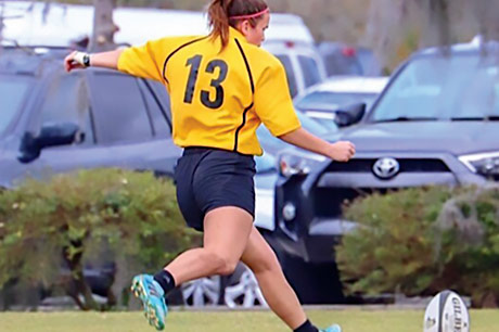 Maddy Ross playing Rugby.