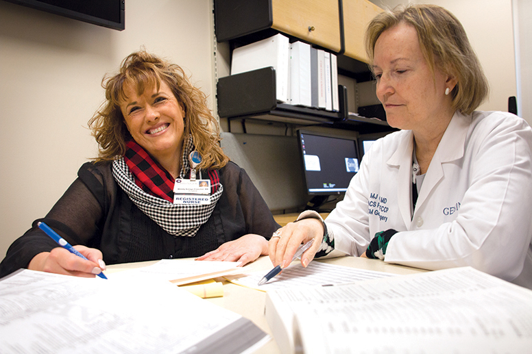 Wendy Baloga-Truschel and two physician advisors review a CDI chart.