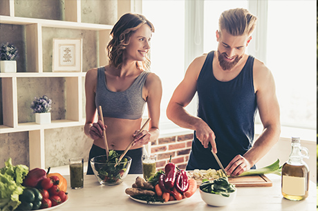 People in kitchen with healthy food
