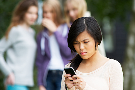 Teen looking at cell phone