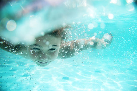 child swimming underwater