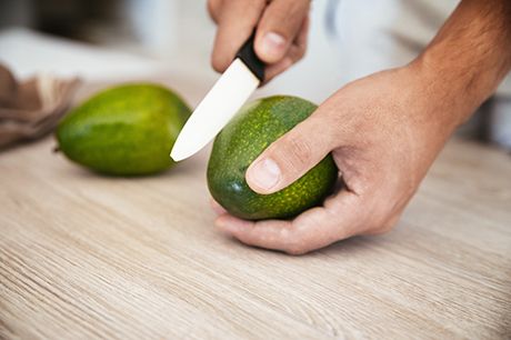 wellness avocado hand cutting safely