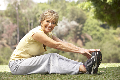 Wellness woman stretching prehab
