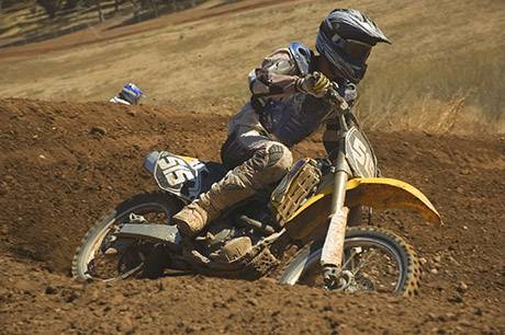 Person riding dirt bike on track