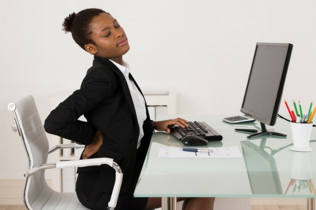 Woman in an office with back pain