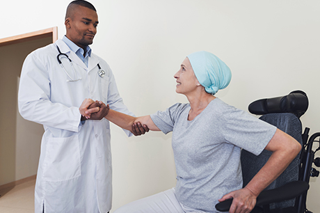 A doctor talking with a cancer patient