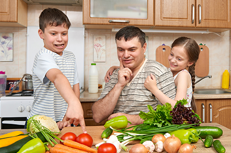 Kids choose vegetables with their father