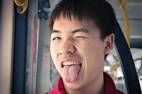 Man with tongue sticking out