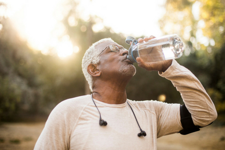 Man drinking from water bottle.