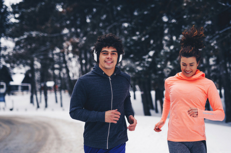 Man and woman running in the winter.