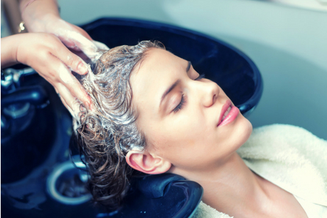Woman having her hair washed at a salon.
