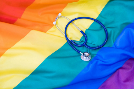 Pride flag with stethoscope on it.