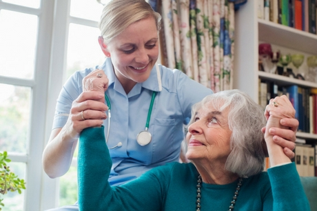 Nurse assisting a stroke patient