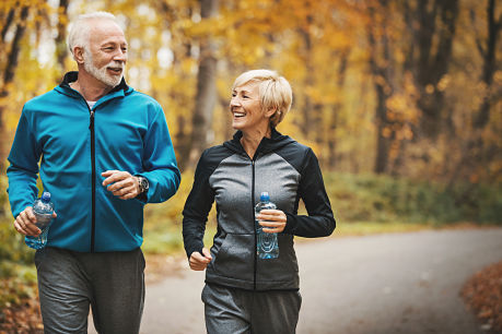 Happy couple exercising regularly to prevent stroke.